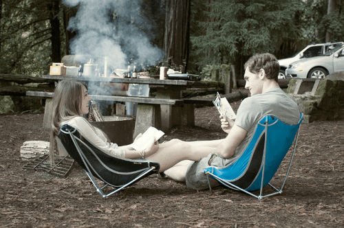 Couple Sitting In Camp Chairs